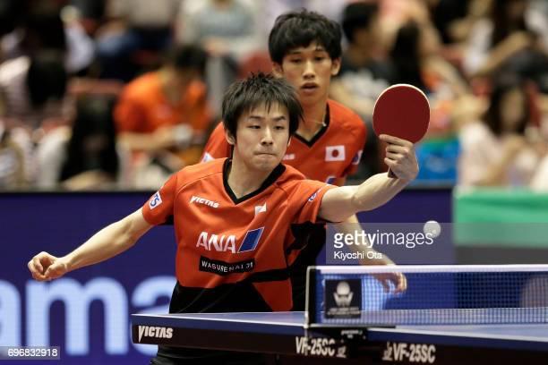 Koki Niwa and Maharu Yoshimura of Japan compete in the Men's Doubles semi final match against Masataka Morizono and Yuya Oshima of Japan during day...
