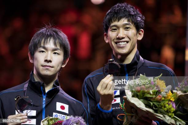 Koki Niwa of Japan and Maharu Yoshimura of Japan pose with a bronze medal during celebration ceremony of Men's Doubles at Table Tennis World...