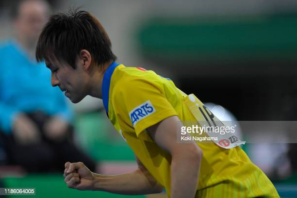 Koki Niwa of Japan celebrates winning against Daniel Habesohn of Austria during Men's Teams singles - Group B - Match 2 on day one of the ITTF Team...