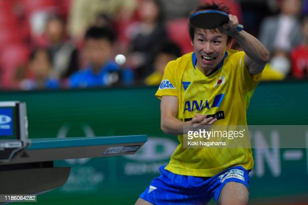 Koki Niwa of Japan competes against Daniel Habesohn of Austria during Men's Teams singles - Group B - Match 2 on day one of the ITTF Team World Cup,...
