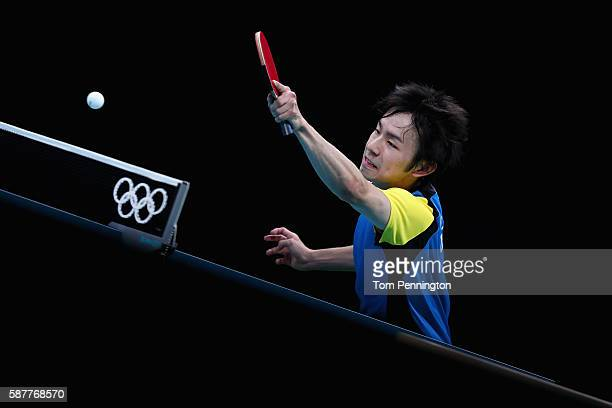 Koki Niwa of Japan competes against Jike Zhang of China during the Men's Singles Quarterfinal 4 Table Tennis on Day 4 of the Rio 2016 Olympic Games...