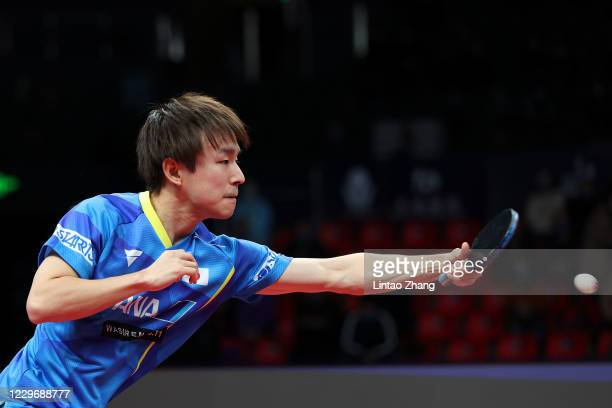 Koki Niwa of Japan competes against Lin Gaoyuan of China in the men's Singles - Round of 16 during day two of 2020 ITTF Finals at Zhengzhou Olympic...