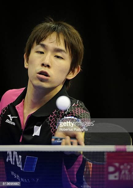 Koki Niwa of Japan competes against Tang Peng of Hong Kong during the 2016 World Table Tennis Championship Men's Team Division quarterfinal match at...