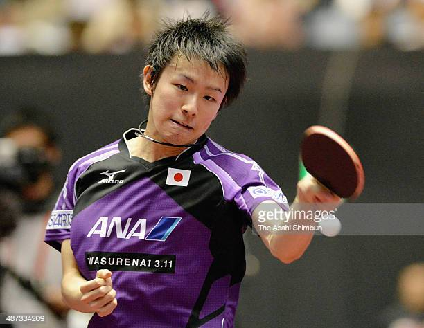 Koki Niwa of Japan competes in the game against Ovidiu Ionescu of Romania during day two of the 2014 World Team Table Tennis Championships at Yoyogi...