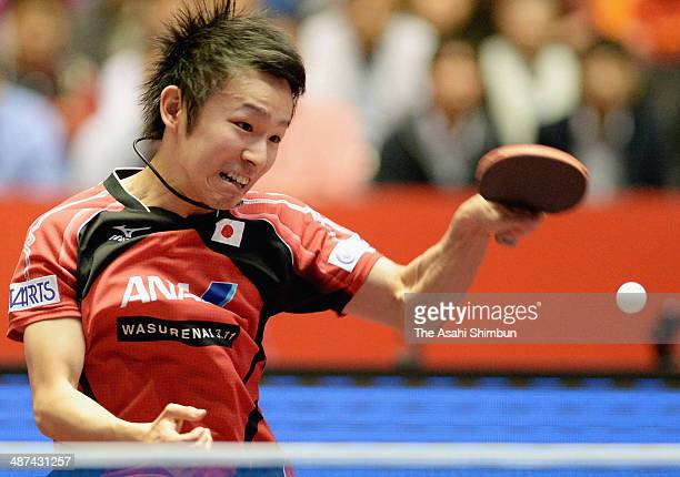Koki Niwa of Japan competes in the game against Tristan Flore of France during three of the 2014 World Team Table Tennis Championships at Yoyogi...