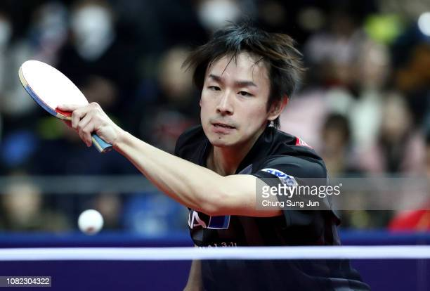 Koki Niwa of Japan competes in the Men's Singles - Round of 16 against Fan Zhendong of China during day two of the World Tour Grand Finals at Namdong...
