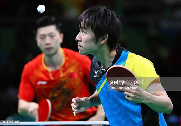 Koki Niwa of Japan serves against Ma Long of China during the the Men's Team Table Tennis gold medal match on Day 12 of the Rio 2016 Olympic Games at...