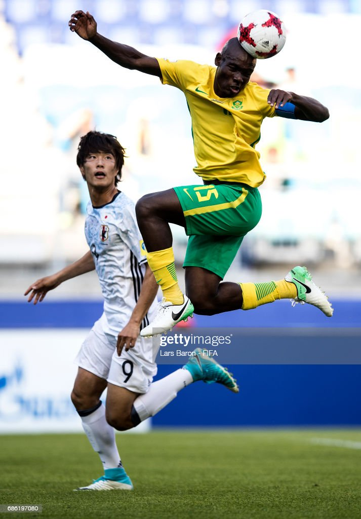 Koki Ogawa of Japan in action with Repo Malepe of South Africa during the FIFA U-20 World Cup Korea Republic 2017 group D match between South Africa and Japan at Suwon World Cup Stadium on May 21, 2017 in Suwon, South Korea.