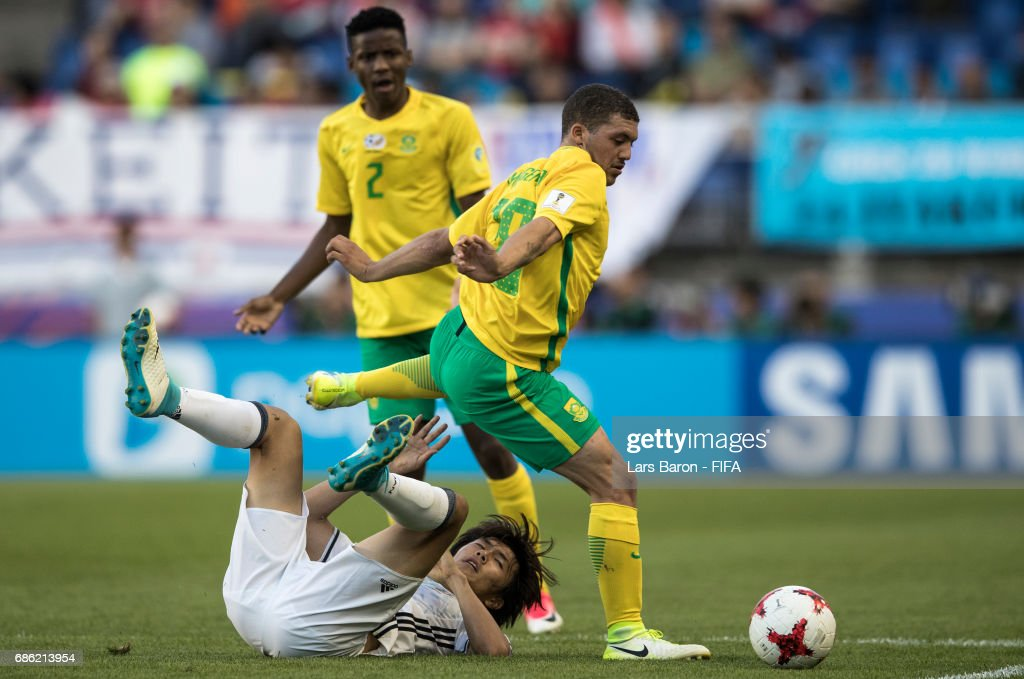 Koki Ogawa of Japan is challenged by Grant Margeman of South Africa during the FIFA U-20 World Cup Korea Republic 2017 group D match between South Africa and Japan at Suwon World Cup Stadium on May 21, 2017 in Suwon, South Korea.