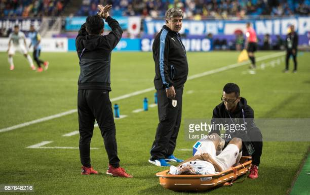 Koki Ogawa of Japan lies injured next to the pitch during the FIFA U20 World Cup Korea Republic 2017 group D match between Uruguay and Japan at Suwon...