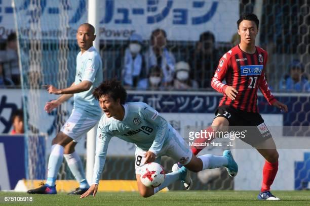 Koki Ogawa of Jubilo Iwata is challenged by Takuma Arano of Consadole Sapporo during the JLeague J1 match between Jubilo Iwata and Consadole Sapporo...