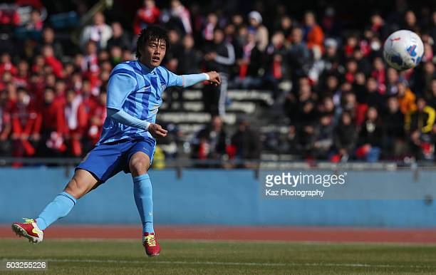 Koki Ogawa of Toko Gakuen shoots at goal during the 94th All Japan High School Soccer Tournament second round match between Toko Gakuen and Nagasaki...