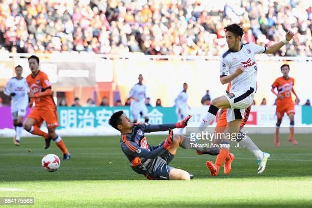 Koki Otani of Albirex Niigata saves a shot by Kenyu Sugimoto of Cerezo Osaka during the JLeague J1 match between Albirex Niigata and Cerezo Osaka at...