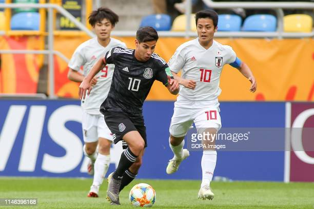 Koki Saito Mitsuki Saito from Japan and Diego Lainez from Mexico are seen in action during the FIFA U20 World Cup match between Mexico and Japan in...