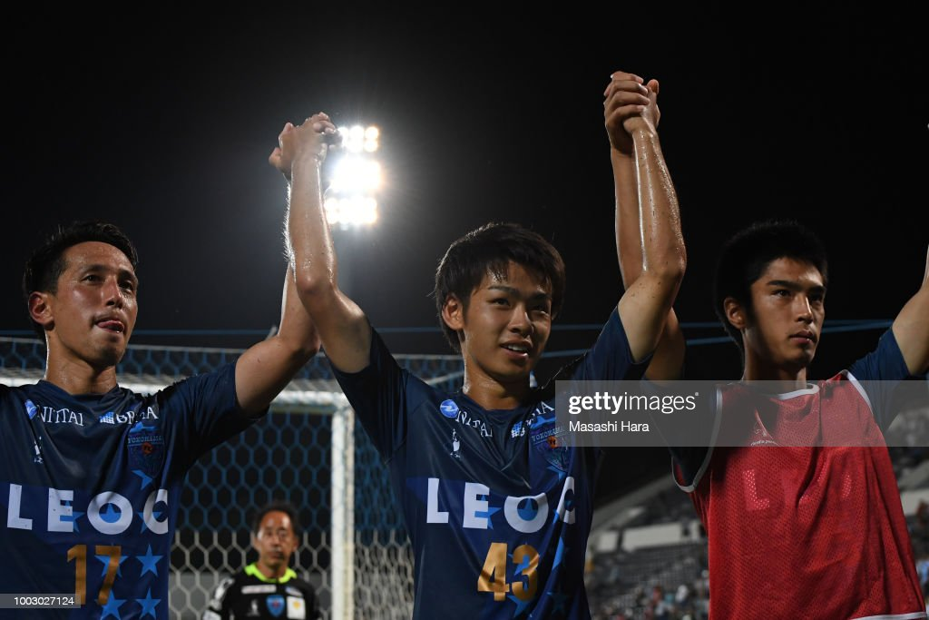koki-saito-of-yokohama-fc-celebrates-the