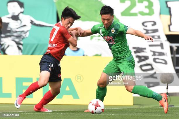 Koki Sugimori of Nagoya Grampus and Shinnosuke Hatanaka of Tokyo Verdy compete for the ball during the J.League J2 match between Tokyo Verdy and...