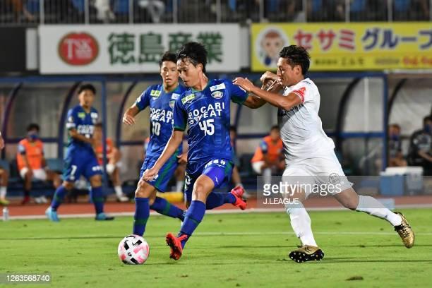 Koki SUGIMORI of Tokushima Vortis and Takumi YAMADA of Montedio Yamagata battle for the ball during the J.League Meiji Yasuda J2 match between...