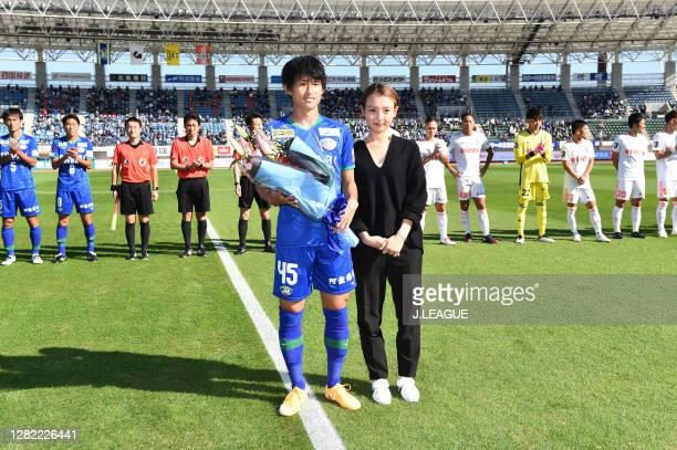 Koki SUGIMORI of Tokushima Vortis celebrates marking his 100th appearance of J.League match prior to the J.League Meiji Yasuda J2 match between...