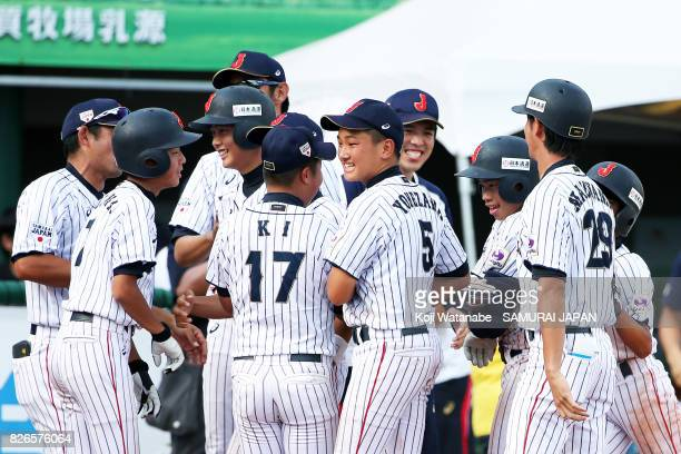 Koki Yamaguchi of Japan celebrates after with teammate their 65 victoty hitting RBI tworun double in the bottom half of the sixth inning during the...