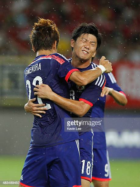Koki Yonekura and Yuki Muto of Japan celebrate after a goal against China during the EAFF East Asian Cup 2015 final round at the Wuhan Sports Center...
