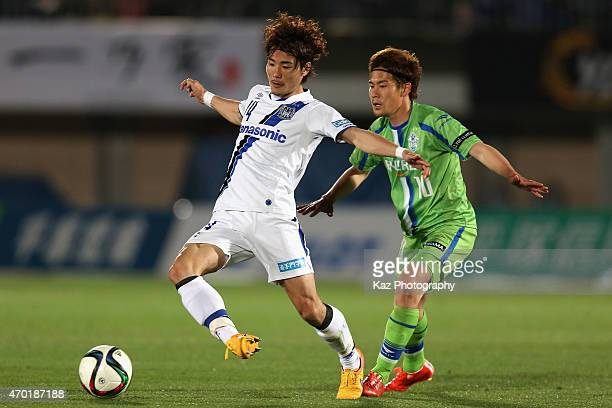 Koki Yonekura of Gamba Osaka and Daisuke Kikuchi of Shonan Bellmare compete for the ball during the J.League match between Shonan Bellmare and Gamba...