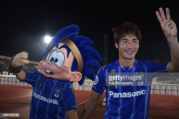 Koki Yonekura of Gamba Osaka who scores the winner thanks to the supporters with the team mascot during the AFC Champions League quarter final match...