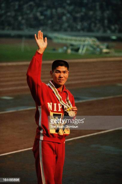Kokichi Tsuburaya of Japan waves to the crowd after winning the bronze medal in the Men's Marathon during the Tokyo Olympic at the National Stadium...