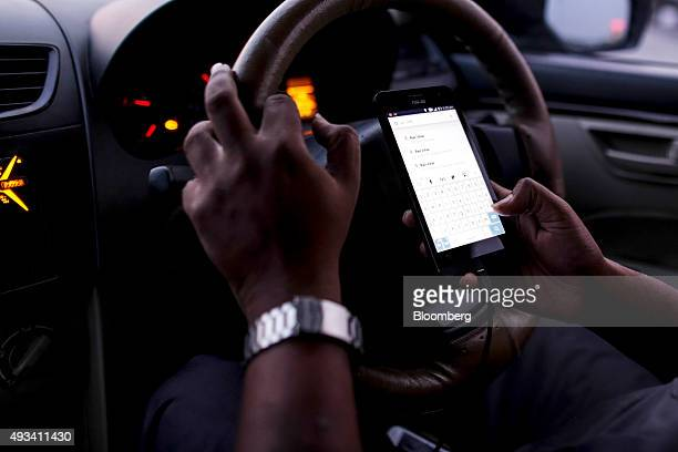 Kokil Agrawal a driver for the Uber Technologies Inc ridehailing service uses the Google Inc Maps application on an ASUS Technology Pte smartphone in...