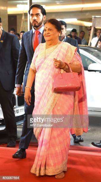 Kokilaben Ambani mother of India's richest man and oiltotelecom conglomerate Reliance Industries chairman Mukesh Ambani arrives with her grandson...