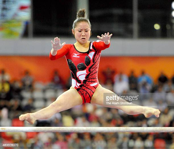 Koko Tsurumi of Japan competes in the Uneven Bars apparatus final during day four of the Guangzhou Asian Games at Guangzhou Gymnasium on November 16...