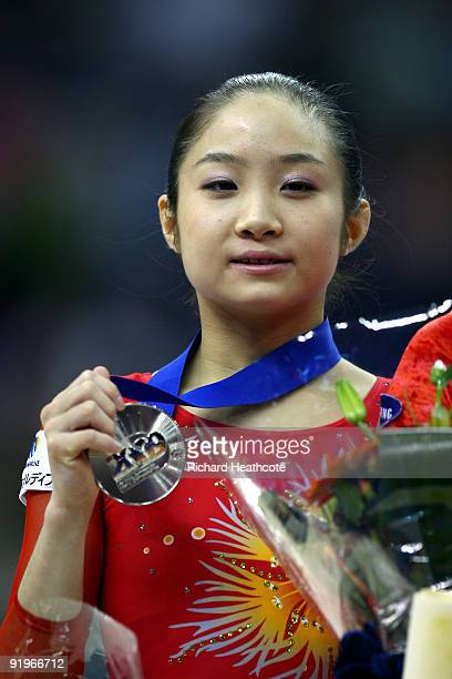 Koko Tsurumi of Japan poses with her silver medal after she came second in the uneven bars event during the Apparatus Finals on the fifth day of the...