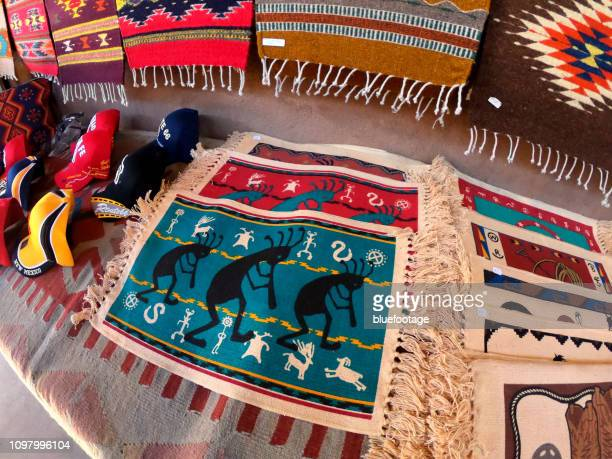 kokopelli table mat - bluefootage stock pictures, royalty-free photos & images