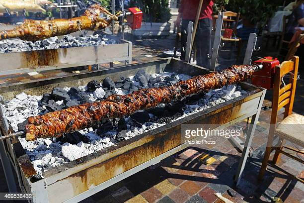SQUARE ATHENS ATTICA GREECE Kokoretsi are barbecued on a spit in Monastiraki Square in Athens Greeks and tourists celebrate the Orthodox Easter...