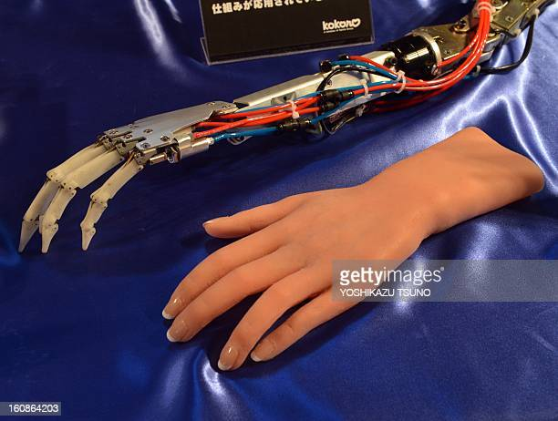 Kokoro a subsidiary of Japanese character goods maker Sanrio displays an artificial hand from the company's humanoid robot 'Actroid' and its internal...
