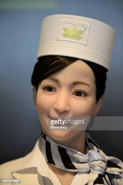 A Kokoro Company Ltd humanoid robot stands at the reception desk of Henn na Hotel operated by Huis Ten Bosch Co a unit of HIS Co in Sasebo Nagasaki...