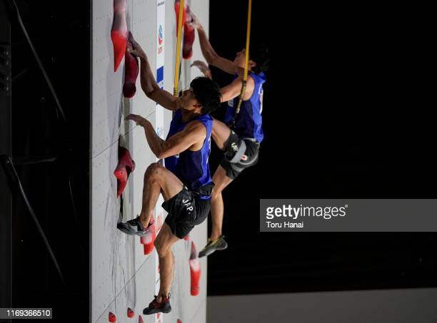 Kokoro Fujii of Japan and Meichi Narasaki of Japan compete in the Speed during Combined Men's Final on day eleven of the IFSC Climbing World...