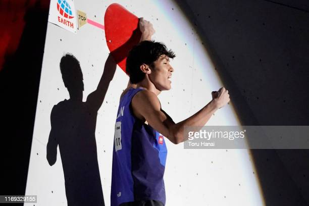 Kokoro Fujii of Japan celebrates while competing in the Bouldering during Combined Men's Final on day eleven of the IFSC Climbing World Championships...