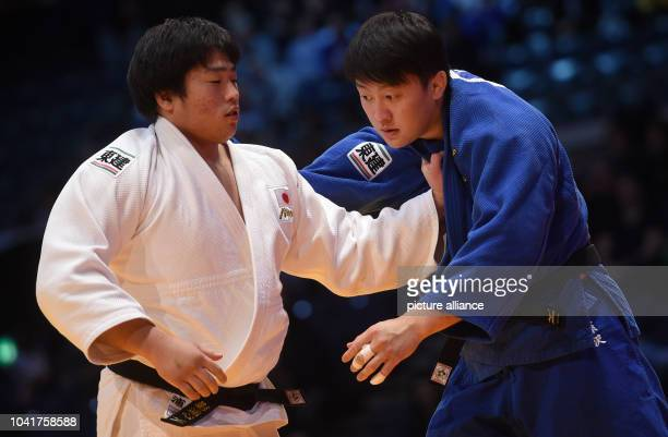 Kokoro Kageura and Hisayoshi Harasawa in action in the men's above 100 kg body weight competition at the Judo Grand Prix in the Mitsubishi Electric...