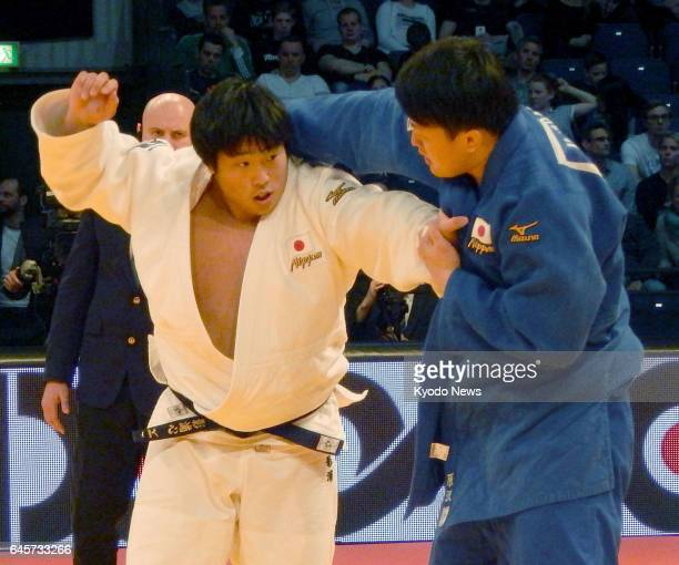 Kokoro Kageura of Japan and compatriot Hisayoshi Harasawa compete in the men's over100 kilogram final at the Judo Grand Prix in Duesseldorf Germany...