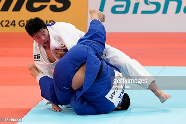 Kokoro Kageura of Japan and David Moura of Brazil compete in the Men's 90kg for the Mixed Team Competition semi final between Japan and Brazil on day...