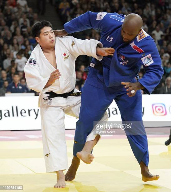 Kokoro Kageura of Japan and Teddy Riner of France compete in the third round of the Paris Grand Slam judo tournament over 100kilogram division on Feb...