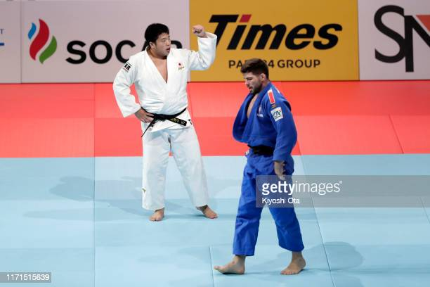 Kokoro Kageura of Japan celebrates his victory over Cyrille Maret of France in the Men's 90kg of the Mixed Team final between Japan and France on day...