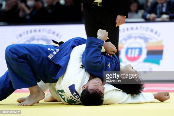 Kokoro Kageura of Japan reacts after winning the Men's 100kg bronze medal match against Tuvshinbayar Naidan of Mongolia on day three of the Grand...