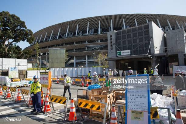 Kokuritsu-Kyogijo Station construction area in front of the newly renovated National Stadium in Shinjuku. Japanese start thinking that it would be...