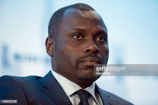 Kola Karim chief executive officer of Shoreline Natural Resources Ltd a Nigerian oil company pauses during the Milken Institute London summit in...
