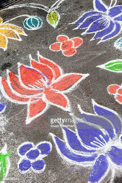 A Kolam decoration outside a house in Pondicherry India Also known as Rangoli Kolam is an art form from India in which patterns are created on the...