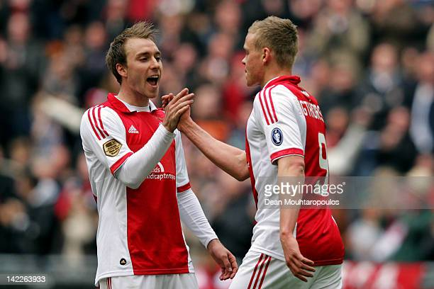 Kolbeinn Sigborsson of Ajax is congratulated by team mate Christian Eriksen after he scores the sixth goal of the game during the Eredivisie match...