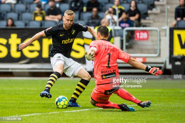 Kolbeinn Sigþorsson of AIK beats IF Elfsborgs goalkeeper Kevin Stuhr Ellegaard to score the opening 1-0 goal during an Allsvenskan match between AIK...