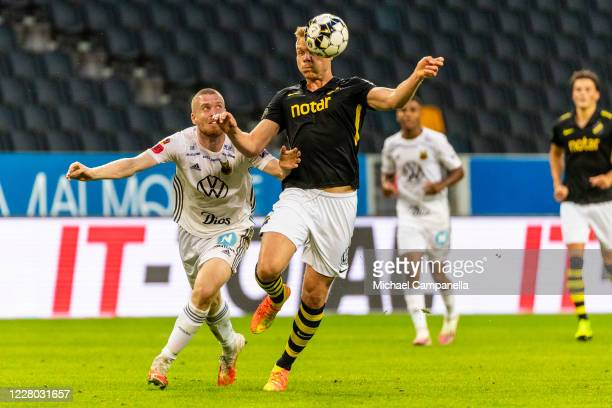 Kolbeinn Sigþorsson of AIK fights for the ball with Thomas Isherwood of Ostersund FK during the Allsvenskan match between Djurgardens IF and Hammarby...