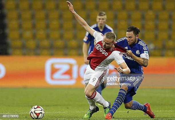 Kolbeinn Sigporsson of Ajax Amsterdam vies with Marco Hoger Schalke 04 during the international friendly soccer match between FC Schalke 04 and Ajax...